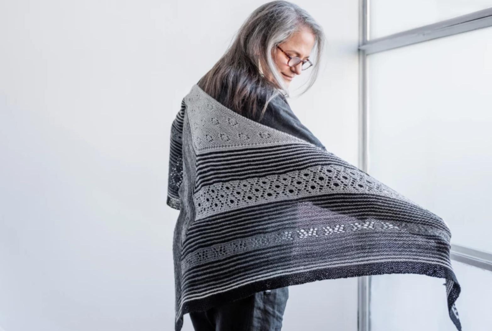 woman showing off high sierra shawl