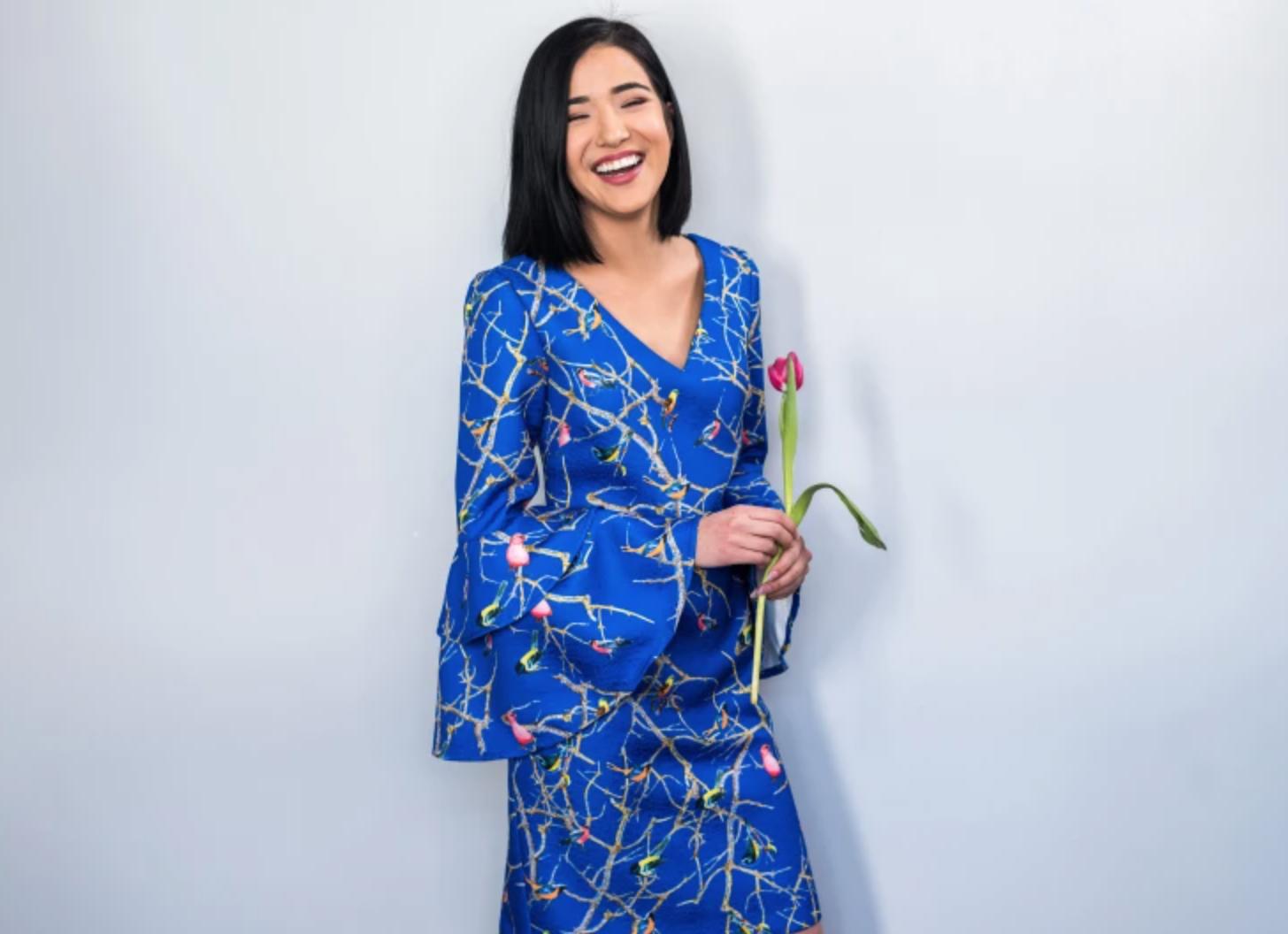 woman wearing blue flirty dress