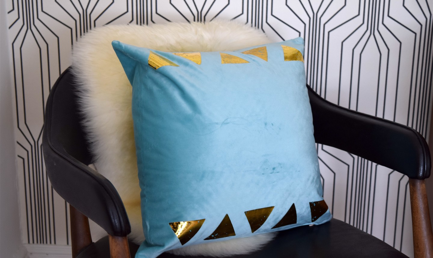 gold triangle pillow on chair