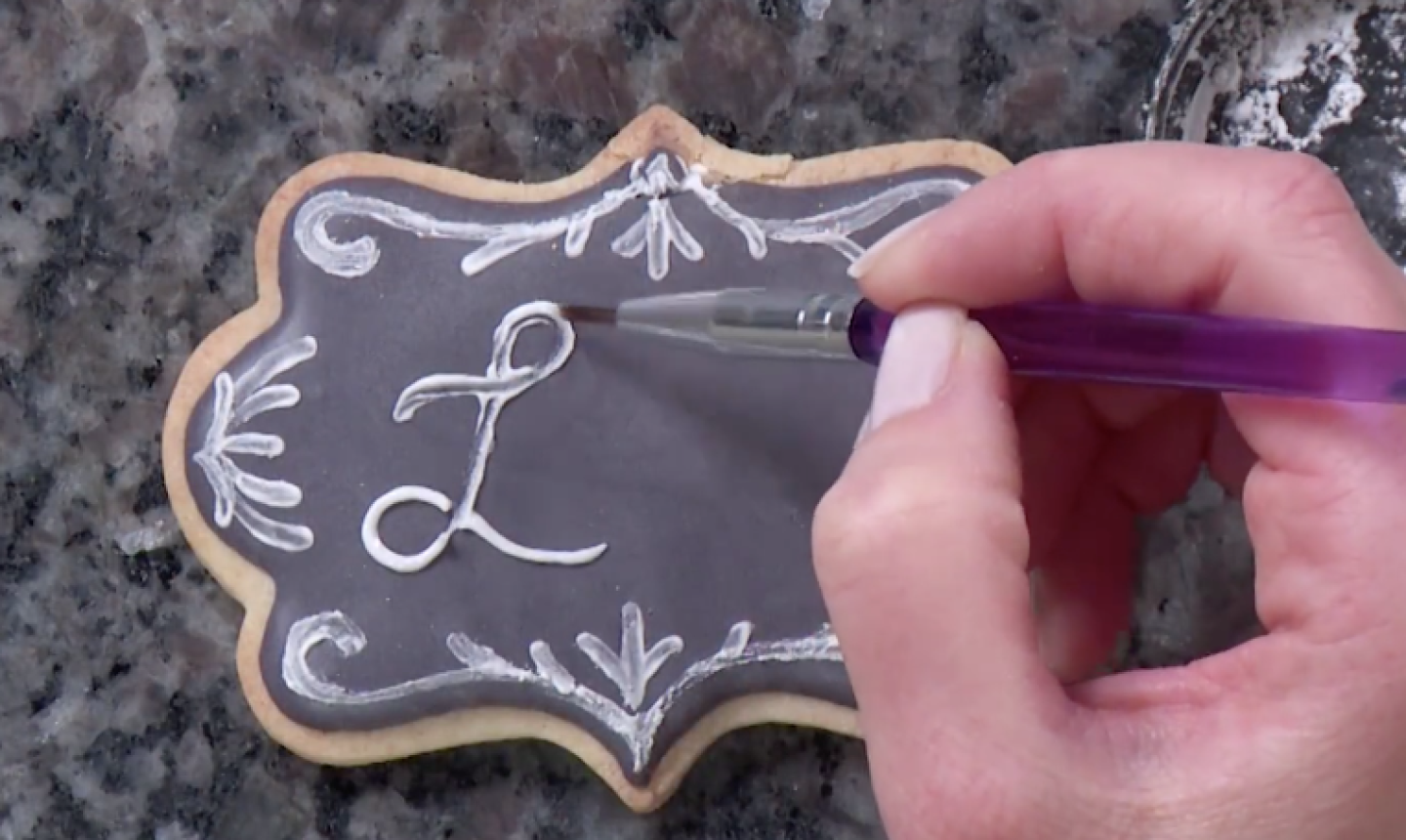 painting words on chalkboard cookie