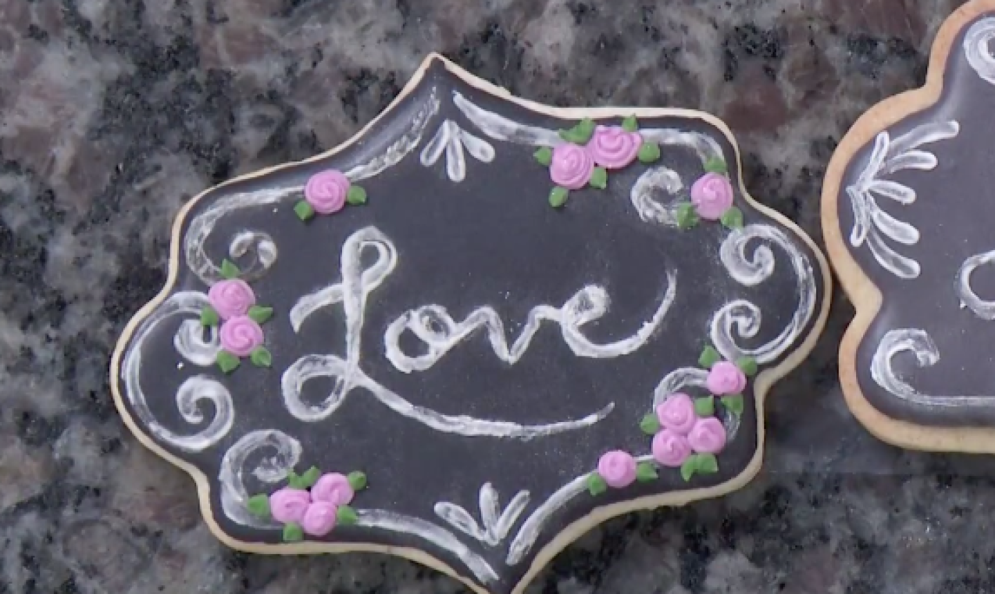 roses on chalkboard cookie