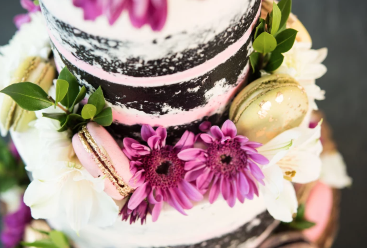 flowers and macaroons on naked cake