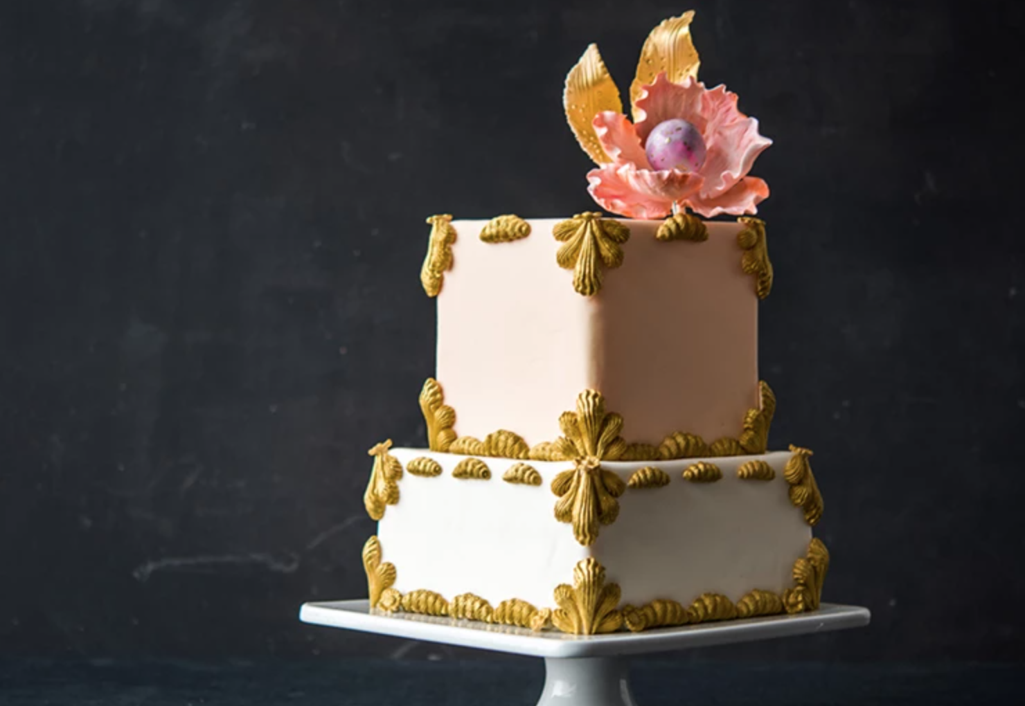 tiered square cake with gold accents