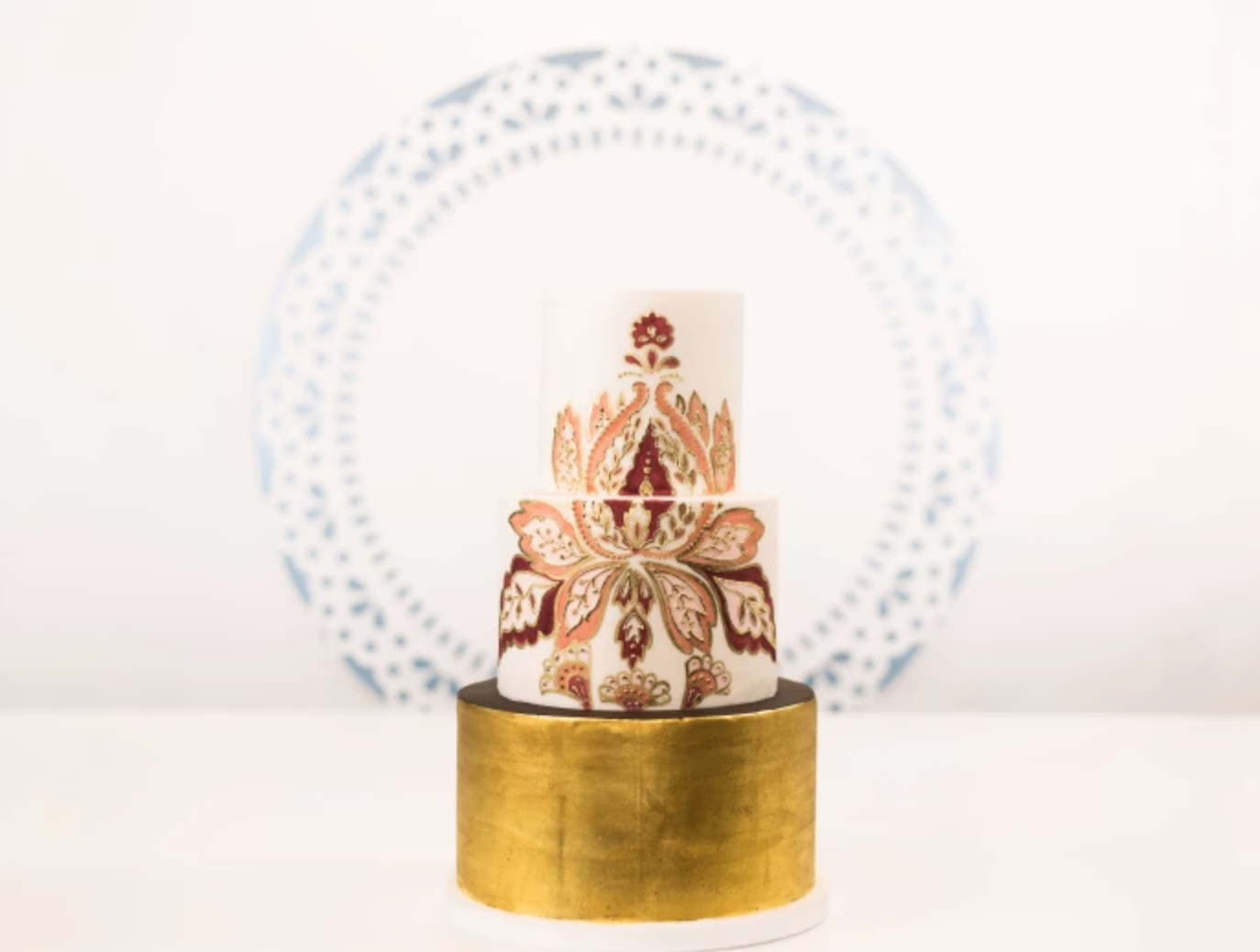 tiered cake with gold leaf base