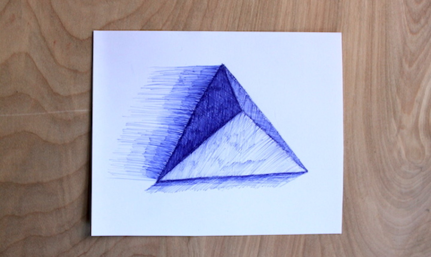 blue pen drawing of triangle