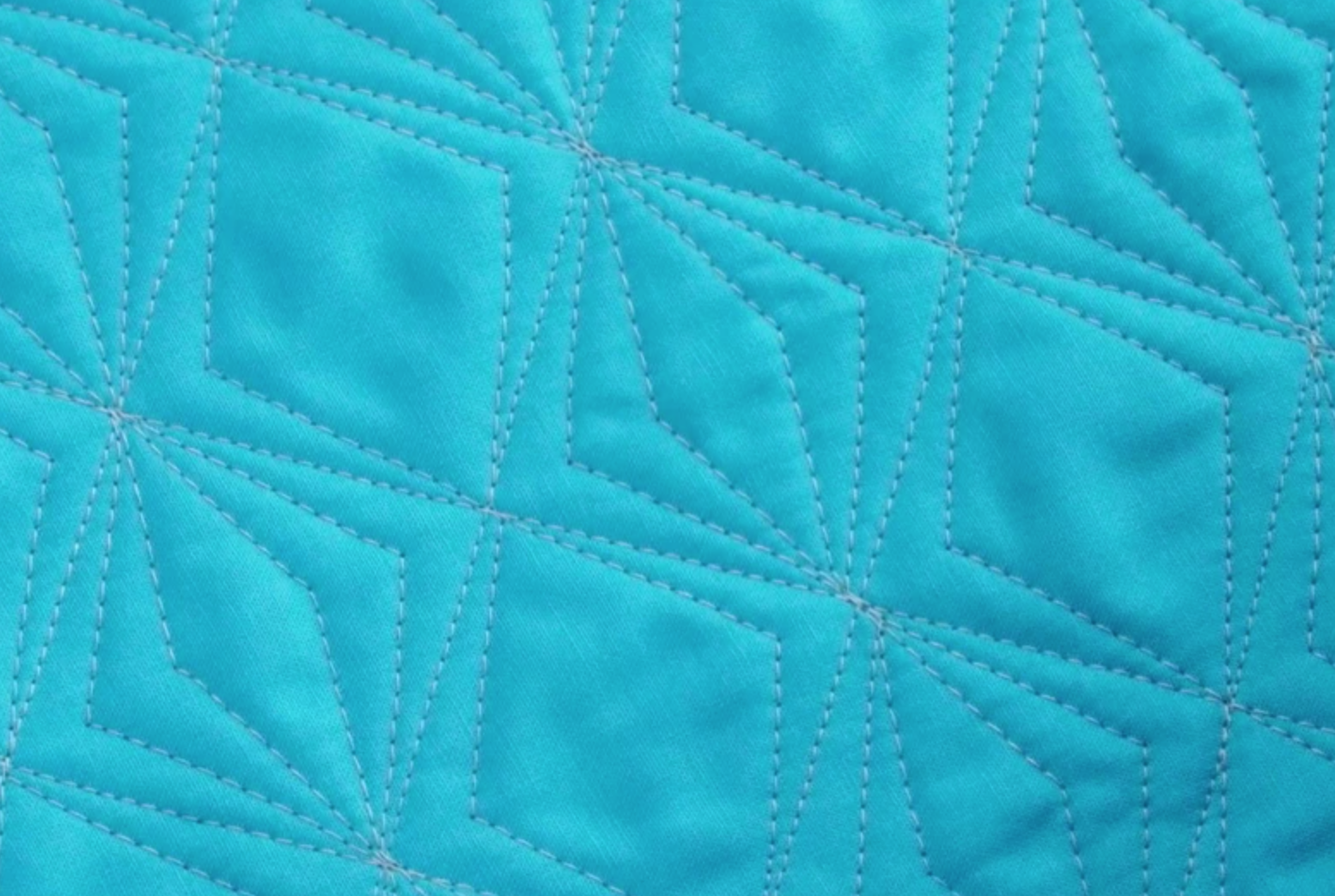 walking foot quilted diamonds on blue fabric