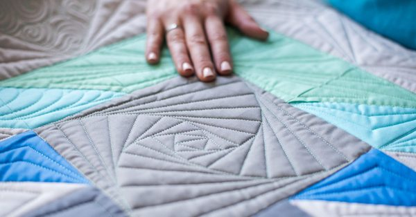 Patterned sewing on quilt squares