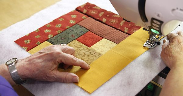 Sewing a scrappy quilt square