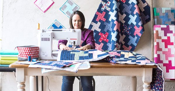 Woman sewing a quilt