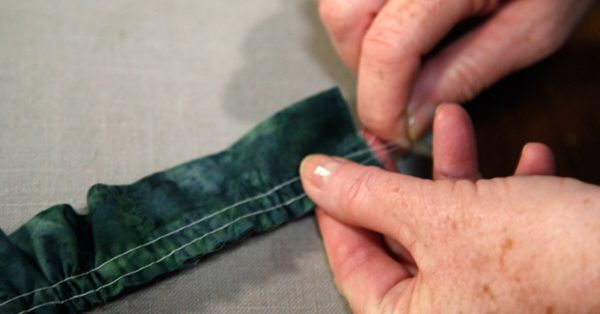 Pulling thread at the end of fabric