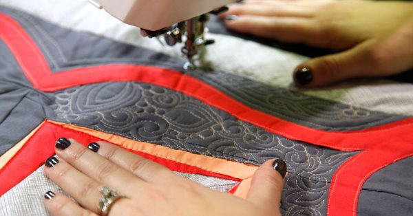 Adding quilting designs to fabric
