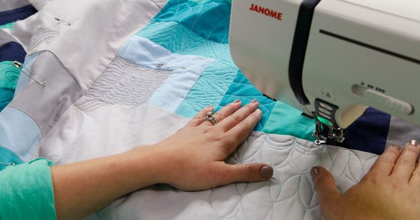 Using a machine to add quilting designs