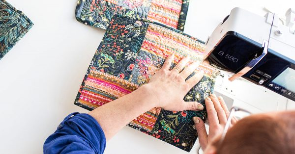 Person sewing a quilt block