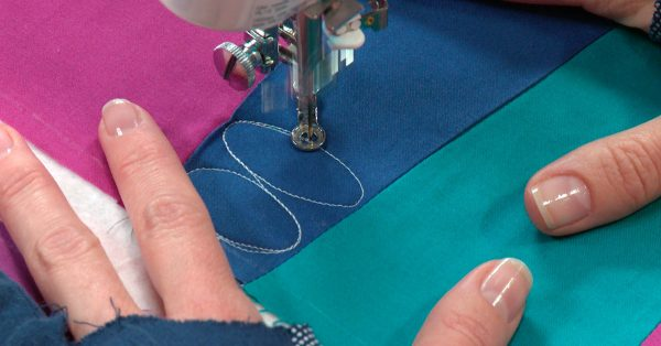 Quilting ovals on blue fabric