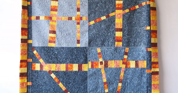 Scrappy stripe sectioned quilt