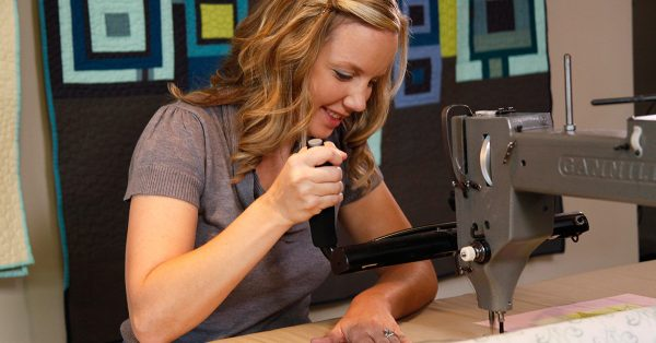 Woman working with crafting machine