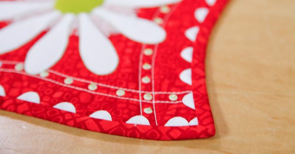 Corner of a white and red quilt
