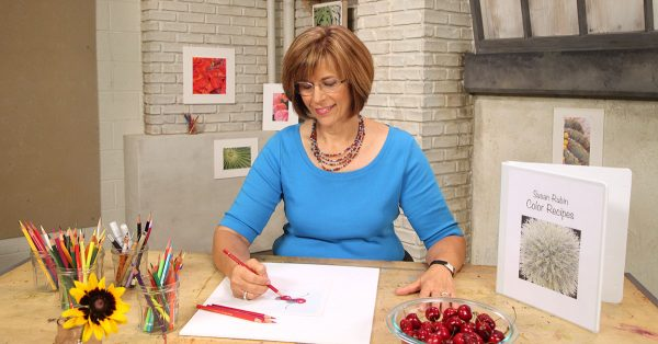 Woman drawing with a red colored pencil