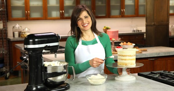 Woman icing a layer cake