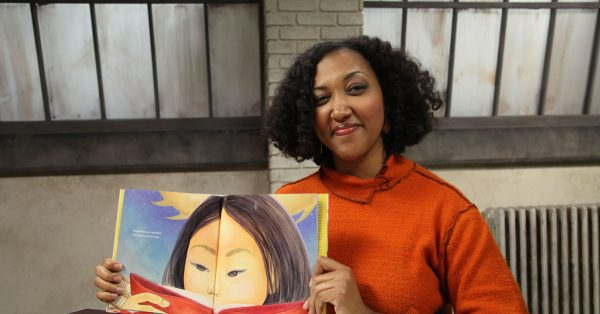 Woman holding open a picture book