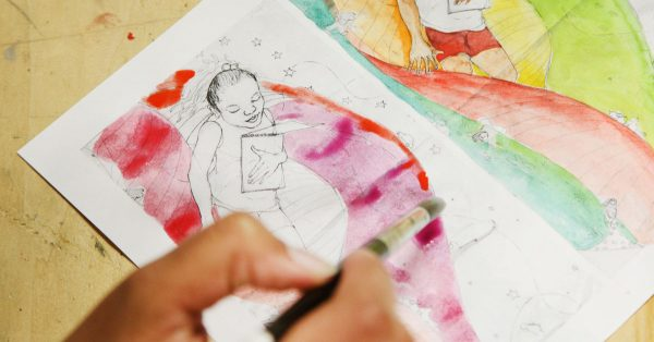Painting watercolor on a picture book picture