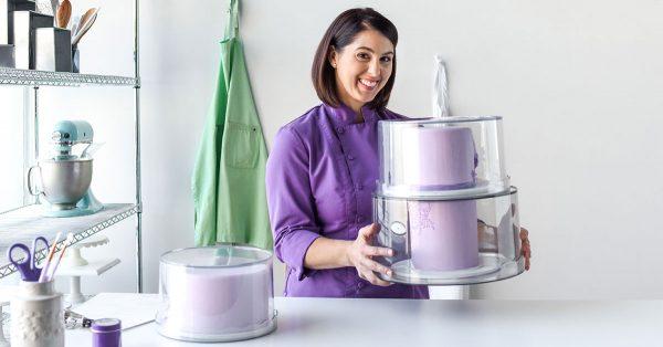 Woman holding a purple cake