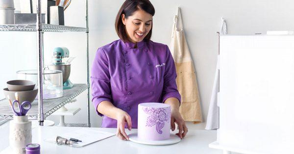 Baker looking at purple cake