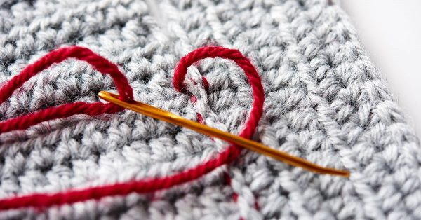 Needle with red yarn