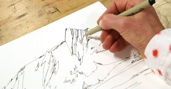 Sketching a landscape with a pen