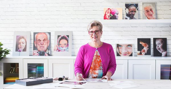 Woman sketching with a colored pencil