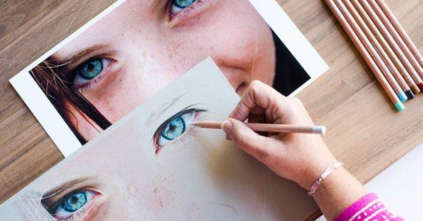 Woman drawing realistic eyes