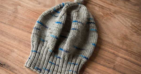 Knit grey hard with blue accents