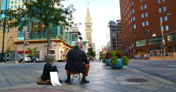 Man sitting outside in a city