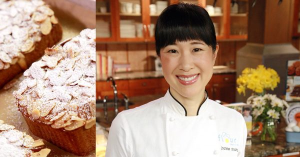Woman in a pastry chef coat with bakery items