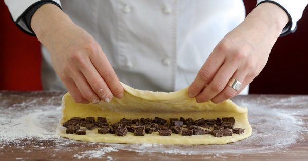 Covering chocolate squares with dough