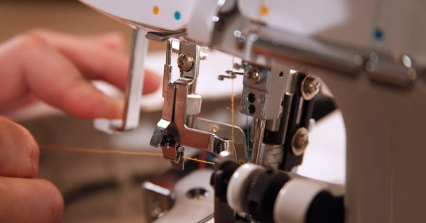 Close up of orange thread through a machine