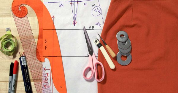 Variety of sewing tools on a pattern