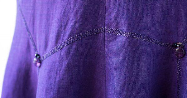 Stitching along purple fabric