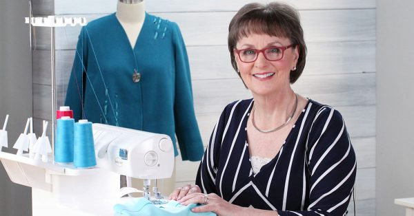 Woman in glasses using a sewing machine