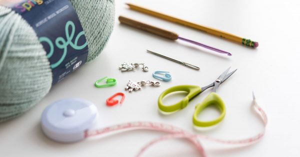 Yarn, needles and sewing scissors