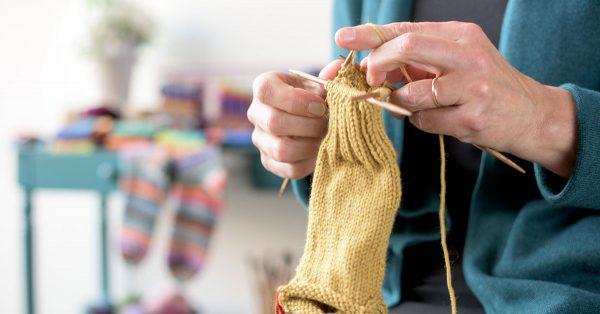 Knitting with yellow yarn