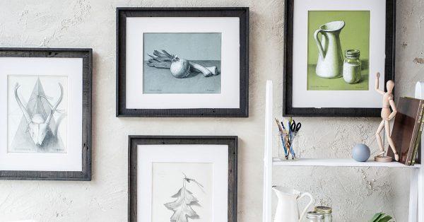 Still life paintings framed on a wall