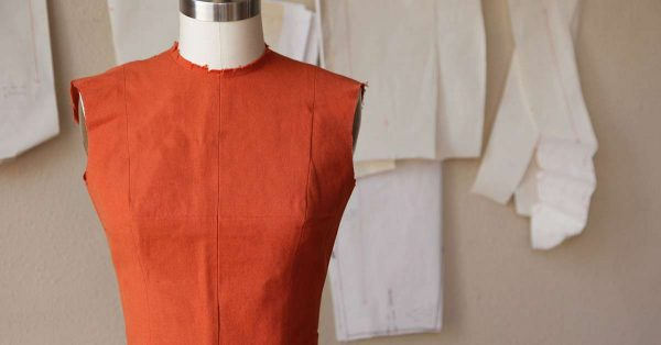 Rust color sleeveless top on a form
