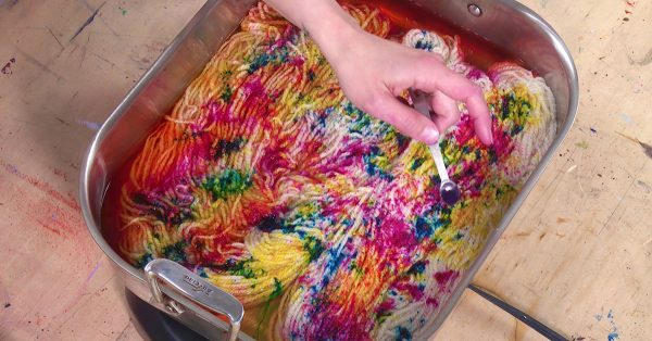 Colorful yarn dying in a pan