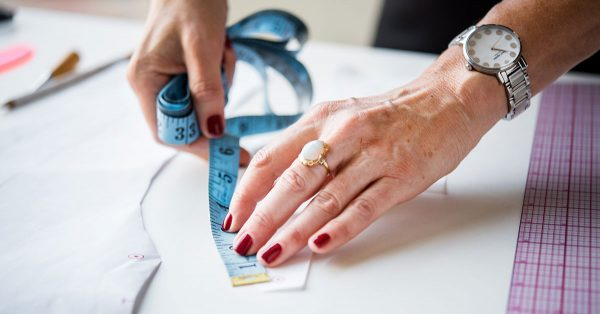 Woman holding a fabric tape measure