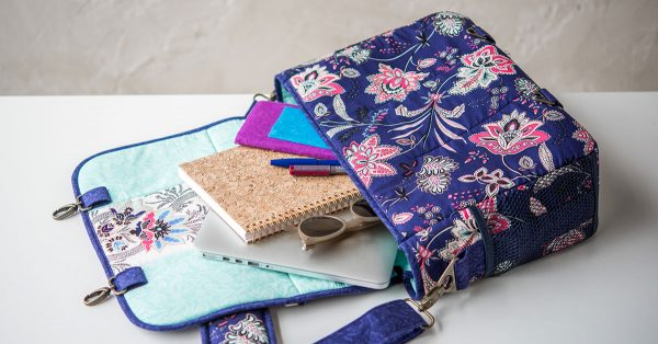 Colorful messenger bag with contents spilling out