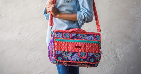 Person wearing a colorful messenger bag