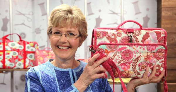 Woman holding up a patterned bag