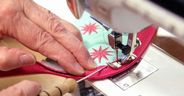 Sewing the hem around a zipper