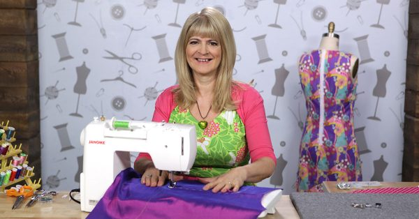 Woman sewing bright fabric on a sewing machine